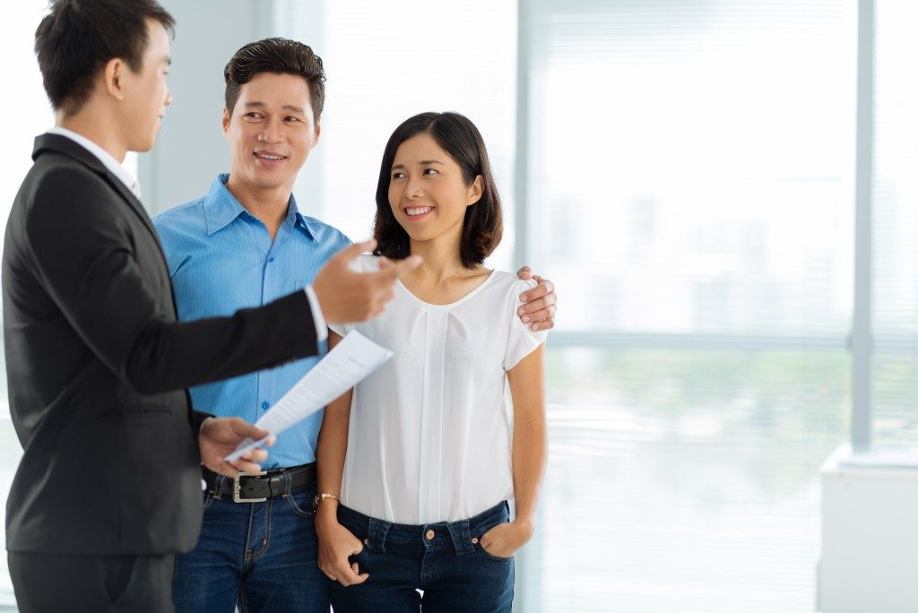 Couples talking to a sales agent