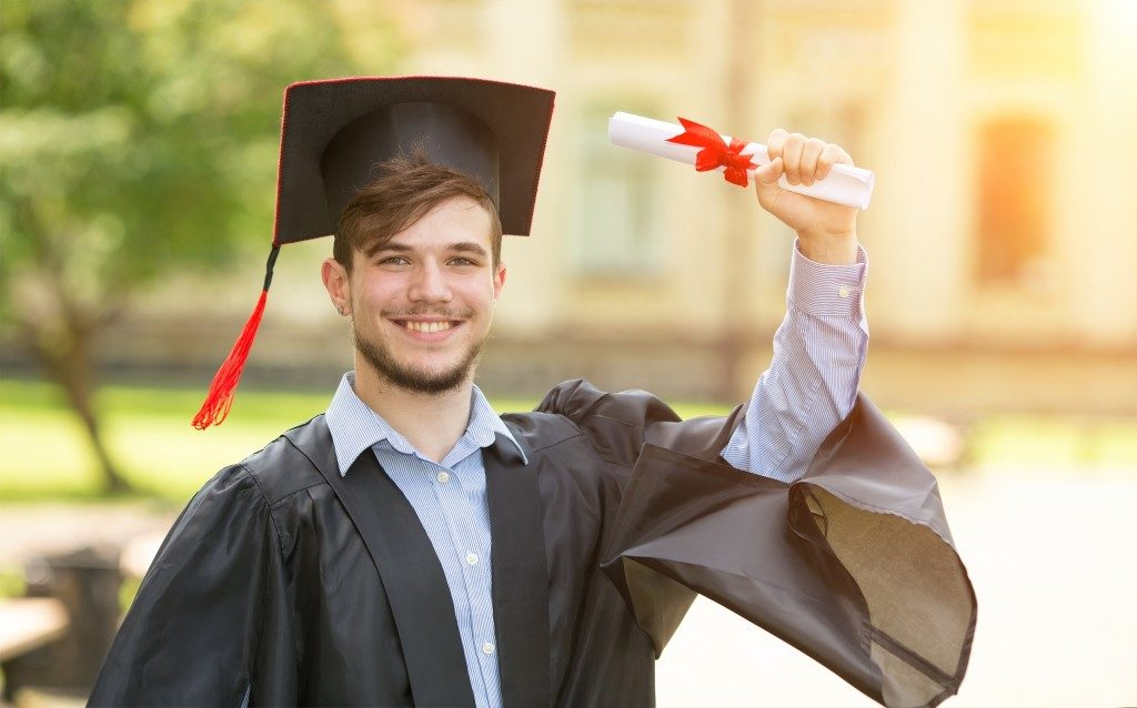 Man finishing his master's degree