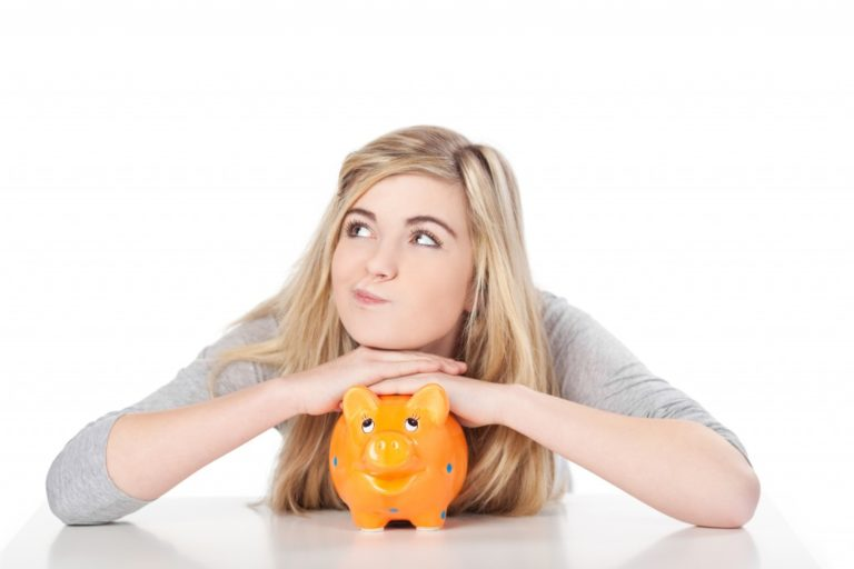 Girl posing with piggy bank