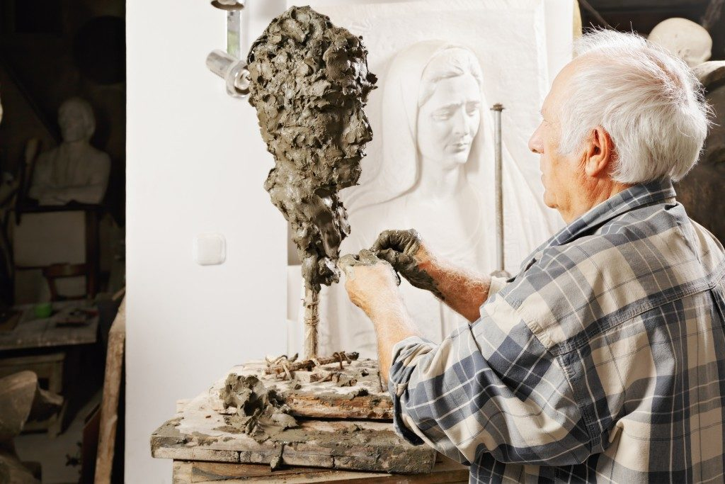 Man sculpting a statue