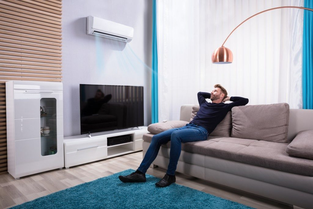 man relaxing in his modern living room