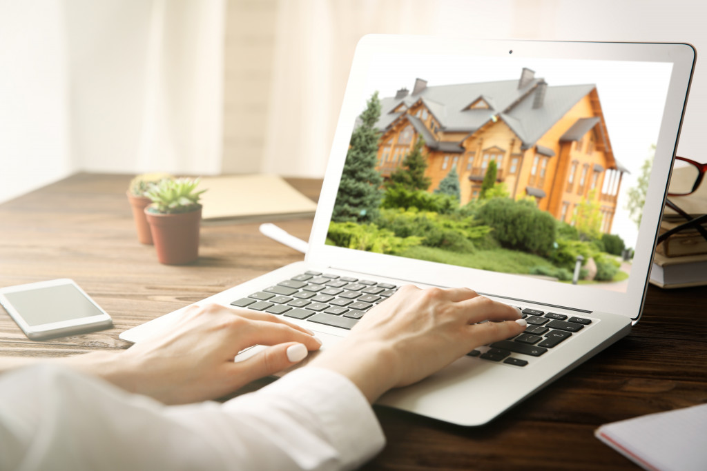 looking at houses on laptop